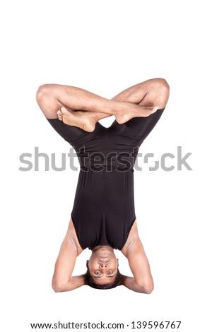 yoga headstand pose in padmasanaindian man in black