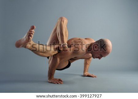 yoga man at the difficult hand standing pose