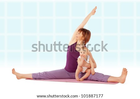 Yoga / Mother with her baby doing yoga exercise