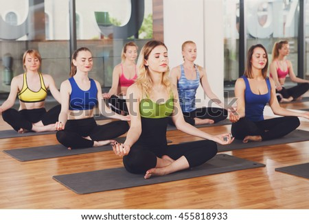 group sportive people doing yoga fitness stock photo