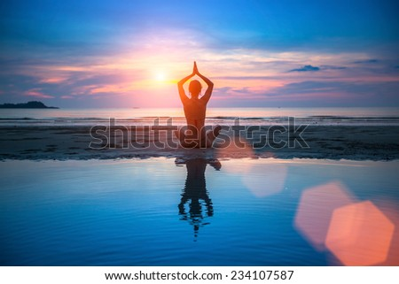 Yoga, silhouette of meditating woman.