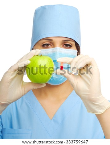 Yougn doctor with pill and apple isolated