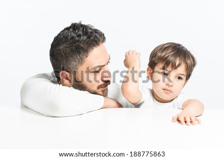 Yound boy angry with his father
