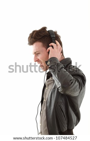 Young adult male with headset listening music isolated on white background