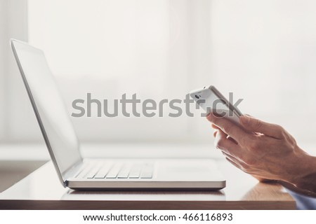 Young adult using smartphone in the office