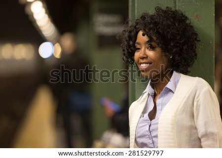 Young African American black woman in subway station platform