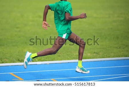 young African athlete won the foot race with long strides and his muscular legs