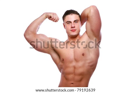 Young and attractive bodybuilder posing on white background