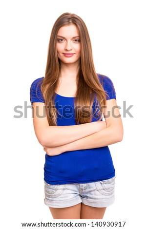 Young and beautiful woman posing isolated over a white background