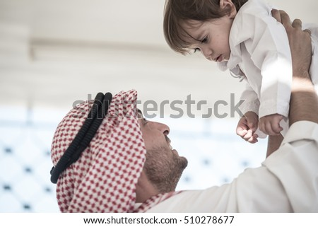 Young Arabic father and kids at home