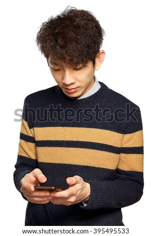 young asia man texting on mobilephone, thinking and looking away.