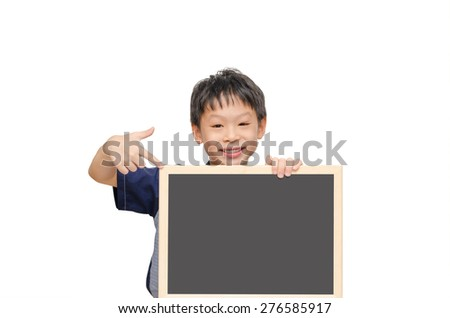 Young Asian boy holding chalkboard and point to it.