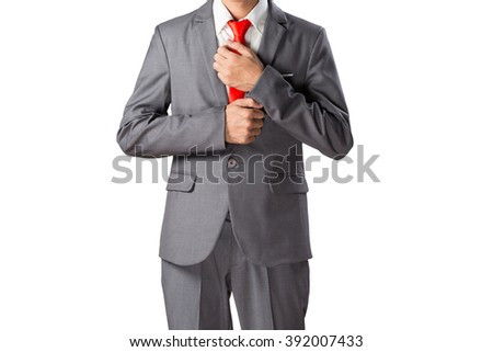 Young asian businessman adjusting red necktie his grey suit