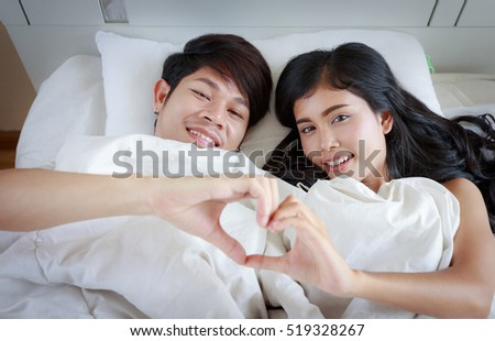 Young Asian Couple Lover Sleeping Under White Blanket On Bed