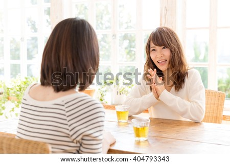 young asian daughter and mother talking in the room lifestyle image