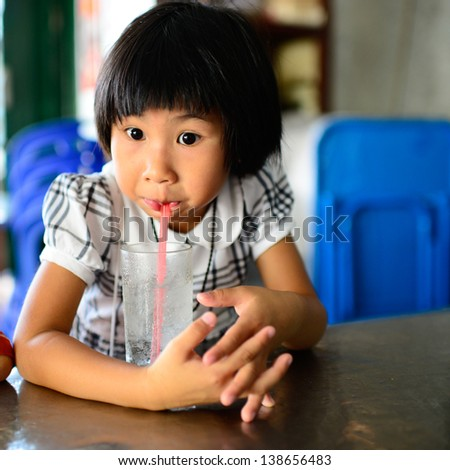 Young asian girl drinking water