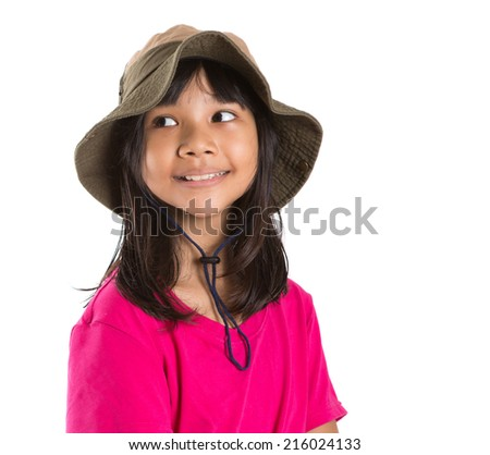 Young Asian preteen girl wearing angler hat and pink tshirt over white background