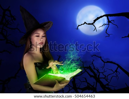 Young asian witch woman with hat standing at night with full moon
