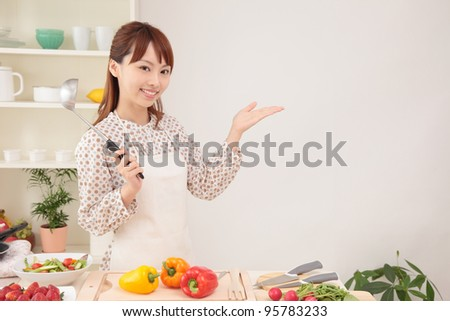 Young Asian woman holding hands in the kitchen