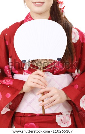 Young asian woman in traditional clothes of kimono with paperfan