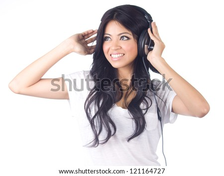 Young asian woman listening to music on white isolated