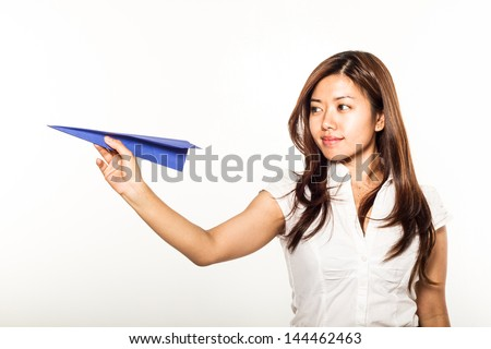 young asian woman with paper plane