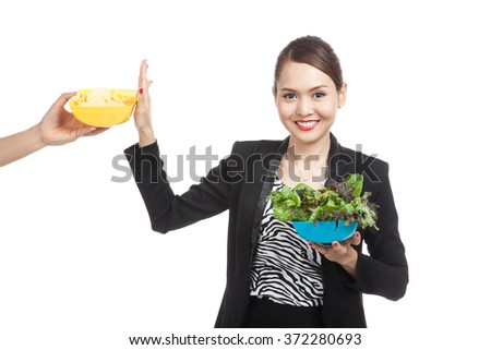 Young Asian woman with salad say no to potato chips  isolated on white background