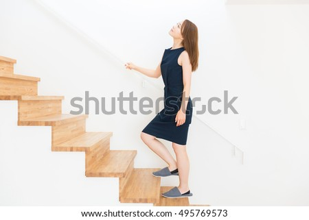 young attractive asian woman who goes up the stairs