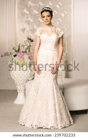 Young attractive bride in wedding dress