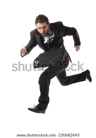 young attractive businessman in athletic pose running late to work wearing suit and tie in stress and overwork or fast success concept isolated on white background