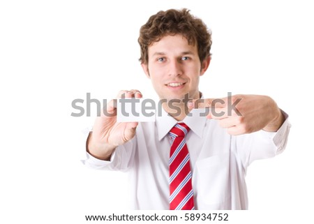 young attractive businessman shows his business card, focus is on card, face is blurred, white empty copy space, studio shoot isolated on white