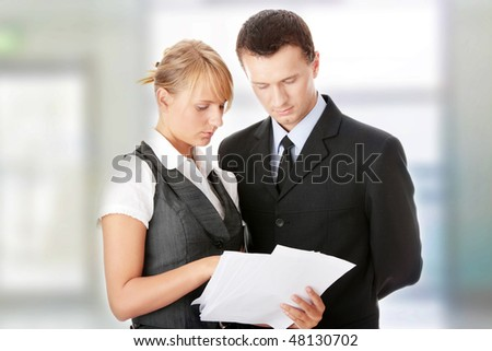 Young attractive caucasian business people in office