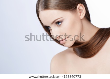 Young attractive girl on a white background