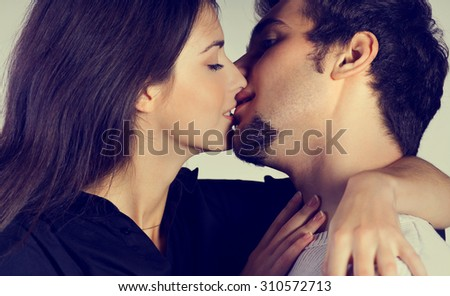 Young attractive happy couple kissing and embracing