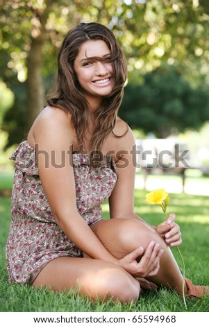 Young attractive happy girl enjoys summer day.