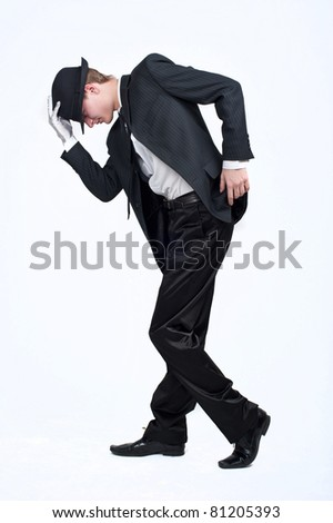 young attractive male dancer guy in the strict business suit, dancing, isolated over white