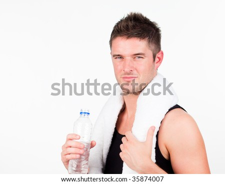 young attractive man engaged in Fitness in gym