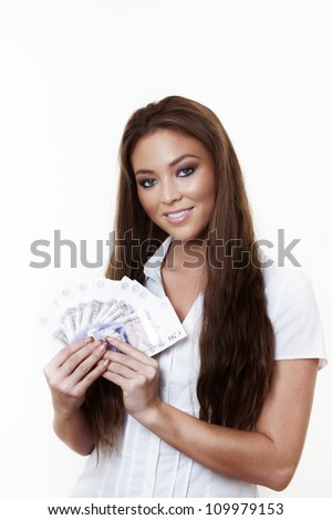 young attractive woman holding a hand full of english back notes