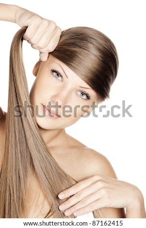 young attractive woman holding her long beautiful natural hair