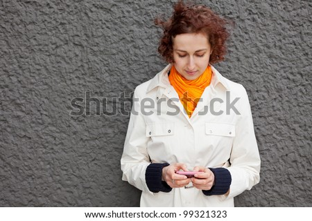 Young attractive woman using her smartphone outdoors
