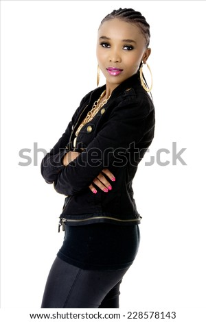 Young Beautiful African Woman Wearing a Black Jacket Golden Jewellery and Pink Lips, Fashion, Studio Shot, Isolated on White Background