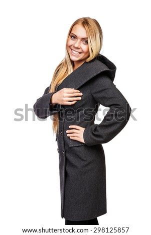 Young beautiful blonde girl in a long black of thick cloth coat with large hood black