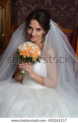 Young beautiful bride. Beautiful woman with wedding bouquet. Beautiful woman with wedding bouquet