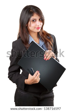 Young beautiful business woman holding file in office.