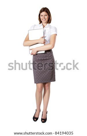 Young beautiful businesswoman standing and holding notebook in both hands