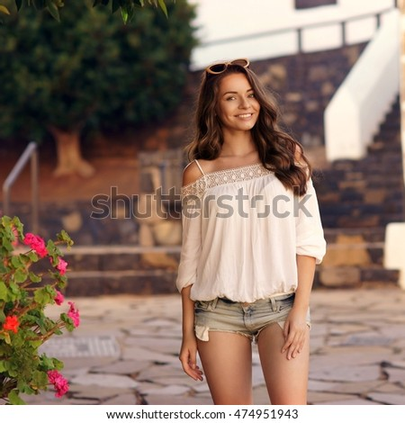 https://thumb10.shutterstock.com/display_pic_with_logo/571009/474951943/stock-photo-young-beautiful-cheerful-woman-walking-on-old-street-at-tropical-town-pretty-girl-looking-at-you-474951943.jpg