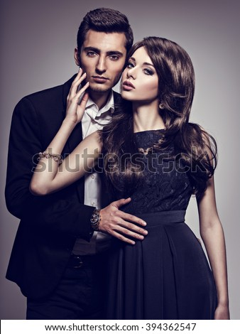 Young beautiful couple at studio