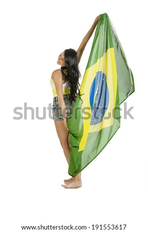young beautiful female Brazil supporter holding Brazil flag