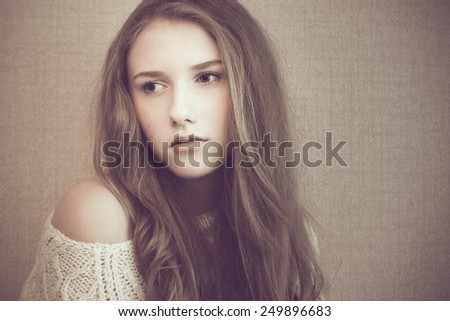 Young beautiful girl looking sad and pensive
