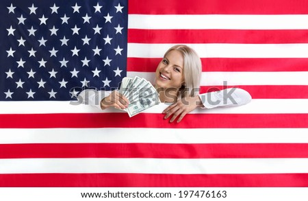 Young beautiful girl with American flag and money